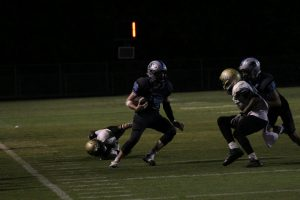 Junior linebacker Ryan Cockes evades a Morrow defender during a punt return. The Panthers defense forced four turnovers and four punts against the Mustangs.