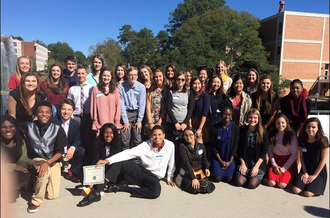"""All 33 of Starr's Mill competitors pose smiling on Clemson University's campus. The students competed in four different languages (French, German, Spanish, American Sign Language) out of a total nine (Chinese, Italian, Japanese, Latin, Russian). This was the 44th Annual Declamation Contest and five-year director Su-i Chen said that she is """"always so proud of our young generation's recognition of the importance of learning a modern language to reach out to the whole world."""""""
