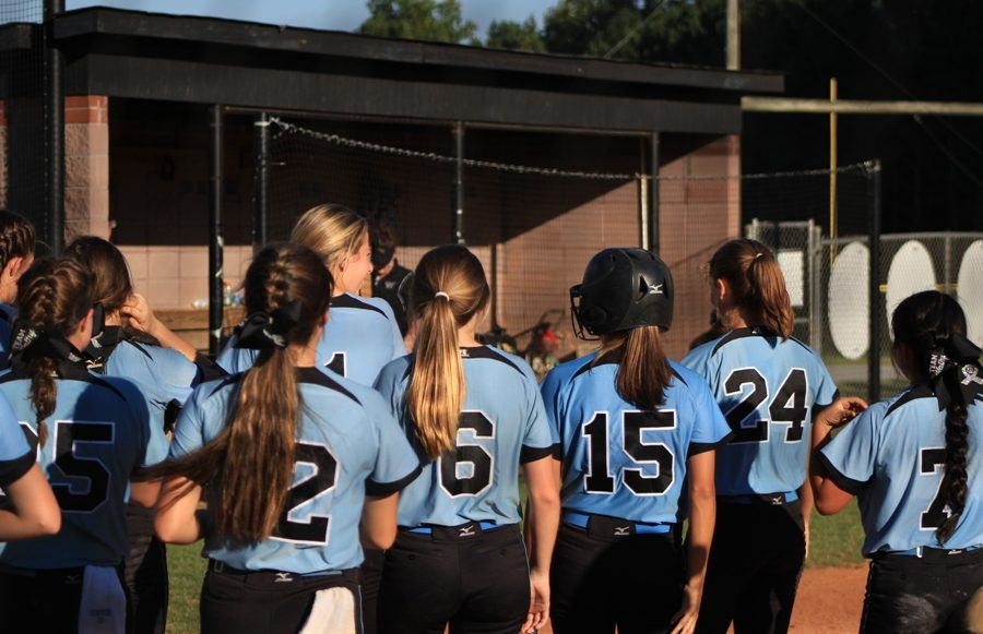The Lady Panthers break from a huddle before the start of their game against Fayette County on Sept. 22. Starr's Mill defeated region opponent Fayette County 17-0 in only three innings.