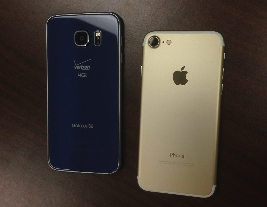 """The Apple iPhone (right) and Android (left) are two of the most popular smartphones among students at Starr's Mill. The iPhone has seen a total of 12 versions, including 's', 'c' and 'plus' categories. The iPhone seven made its debut on Sept. 7, 2016 and senior Richard Smith couldn't have been happier. """"I love my phone,"""" Smith said."""