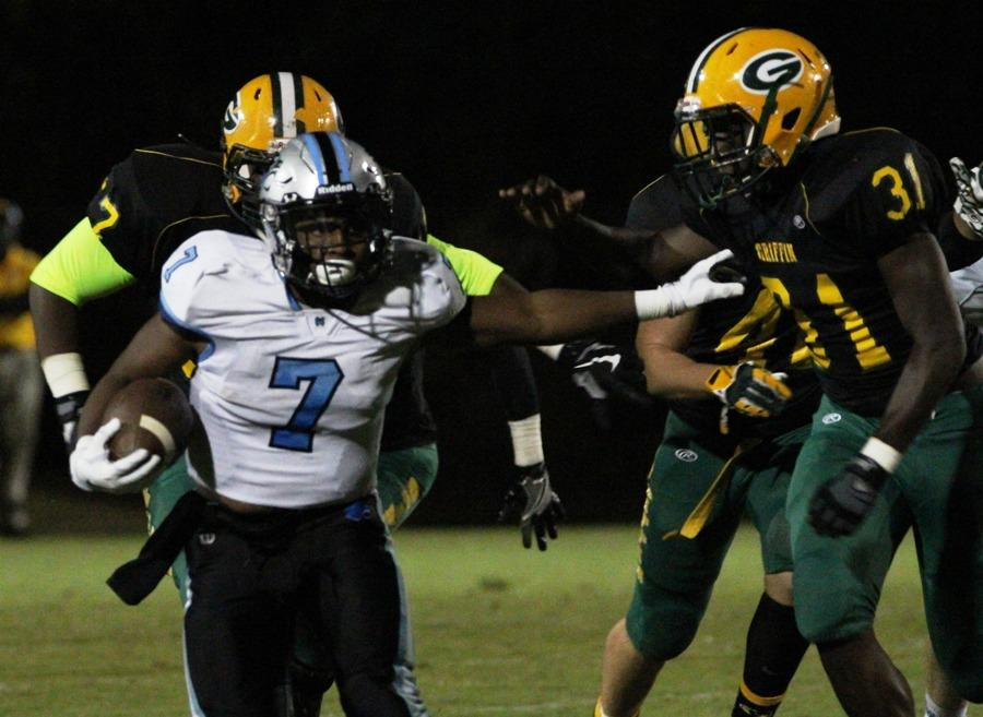 Nick Brown stiff-arms a Bear defender on a run against Griffin. Brown accounted for 92 yards and two scores in the Panthers' 52-49 victory.
