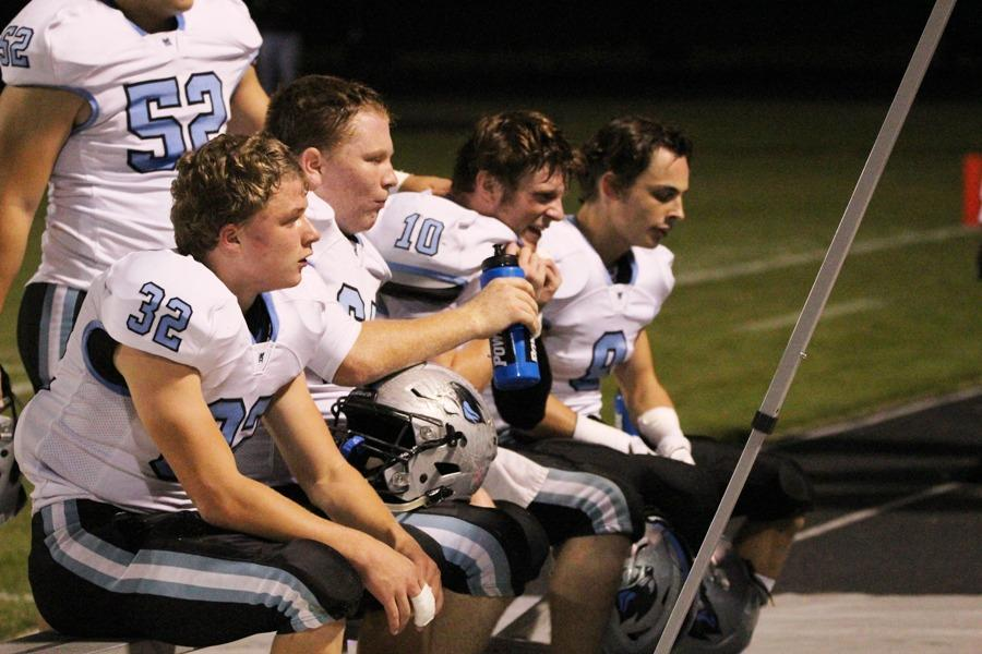 Members of the Panther defense sit to watch film during Friday night's contest. After a Gilley fumble, the defense had to step up to end the Tigers' third quarter surge.