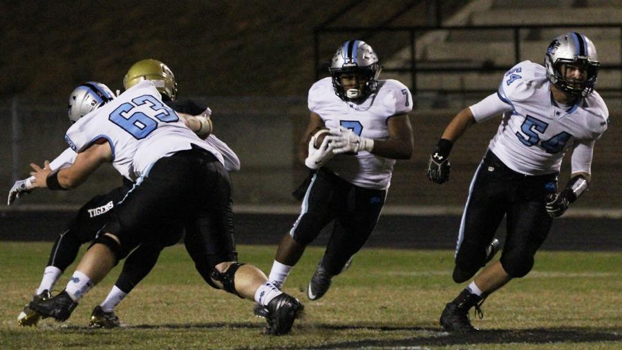 Junior running back Nick Brown bursts through a gap for a big gain against the Tigers. Brown's 88 yards on Friday night pushed his season total to 876 yards to go along with his nine touchdowns throughout the regular season.
