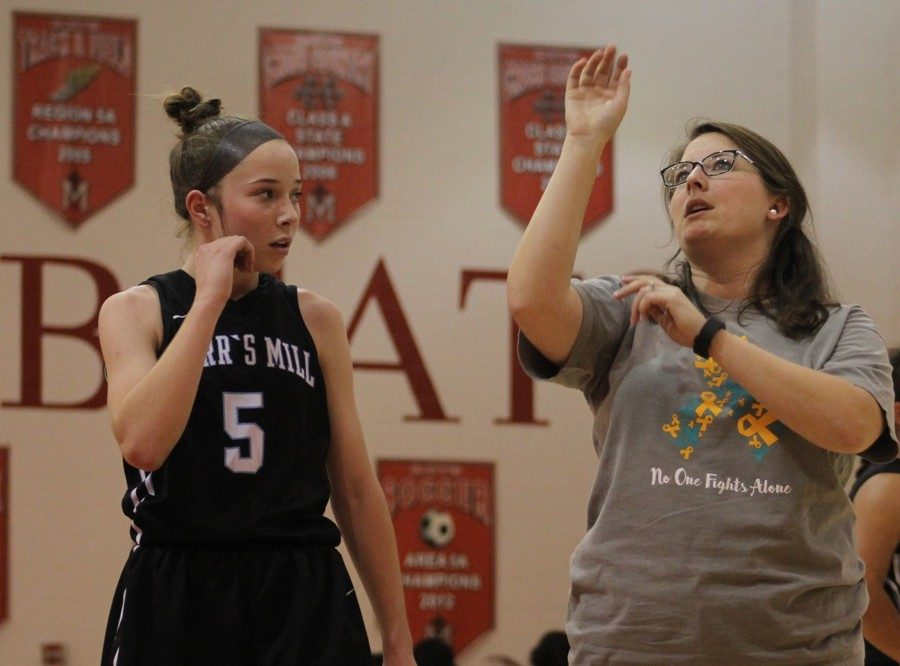 Assistant coach Emily Woodward coaches a Lady Panther in shooting. The Panthers won their first scrimmage against Our Lady of Mercy, 40-27, on Wednesday night.
