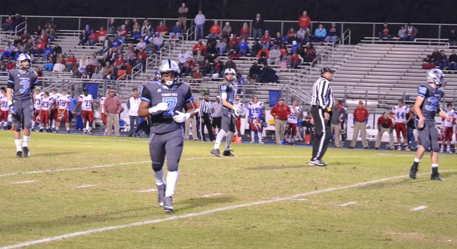 Junior Nick Brown jogs back to the sideline after a play against Veterans. With the Panthers 38-17 victory, they advance to the second round to host the 9-2 Kell Longhorns.