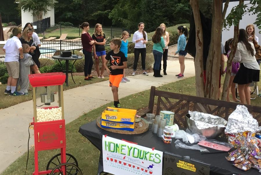 """""""The event required a lot of volunteers,"""" freshman and organizer of the Fayette Humane Society fundraiser Marissa Heinsz said. During the event, Heinsz and other high school volunteers spoke with attendees and worked the snack bar. The snack bar was named after the candy shop, Honeydukes, from the J.K. Rowling series """"Harry Potter""""."""