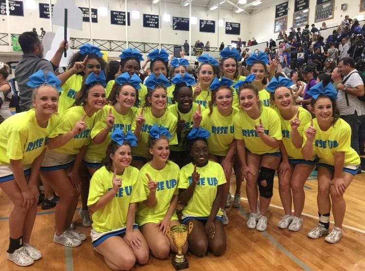 Starr%E2%80%99s+Mill+varsity+cheer+team+poses+for+a+picture+after+winning+the+region+title.+The+team+looks+to+continue+their+success+at+state+this+weekend.