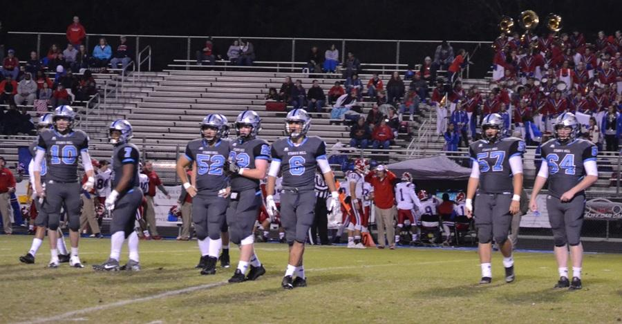 Members of the Panther defense look toward the sideline to listen for the next playcall. The defense forced two interceptions and recovered two fumbles on special teams to help the Panthers move into the second round of the AAAAA GHSA State Playoffs.