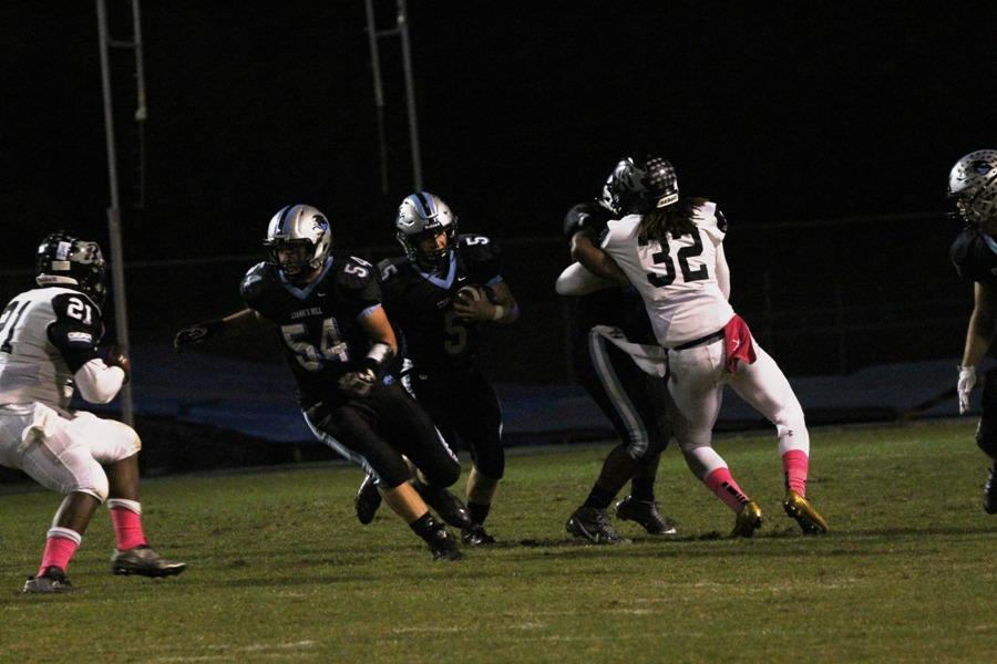 Panther offensive line makes a hole for junior Mitch Prowant. The offensive line played a huge role in the Panthers breaking the school record for rushing yards in a single game with 526.