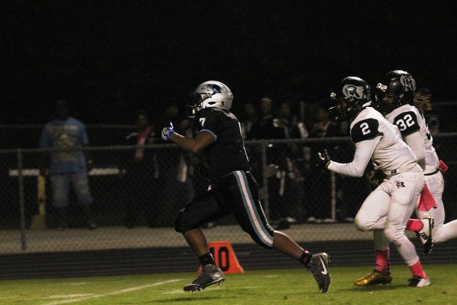 Junior Nick Brown leaves behind the Raider defense on the way to one of his touchdowns against Riverdale. Brown led the way with 200 yards for the Panthers and they look to carry that run game into their last regular season game against Fayette County on Nov. 4 at 7:30 p.m.