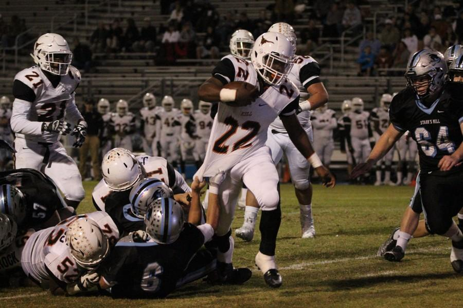 Panther defenders try to bring down a Longhorn running back. The Panthers were rarely out-rushed this season, but Kell managed to do so 318-301.