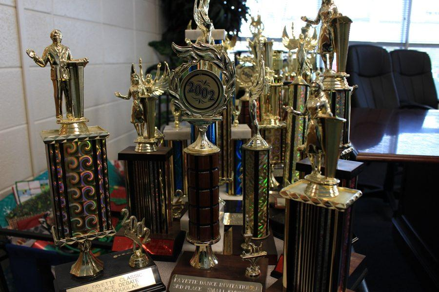 Trophies+begin+to+pile+up+as+front+office+secretary+Leslie+Frey+catalogs+them+before+handing+them+off+to+the+coaches.+The+school%E2%80%99s+most+important+trophies+will+be+placed+chronologically+around+the+rotunda.+Additional+trophies+will+be+given+to+the+coaches+at+the+Mill%2C+who+will+then+have+to+figure+out+what+to+do+with+them.+