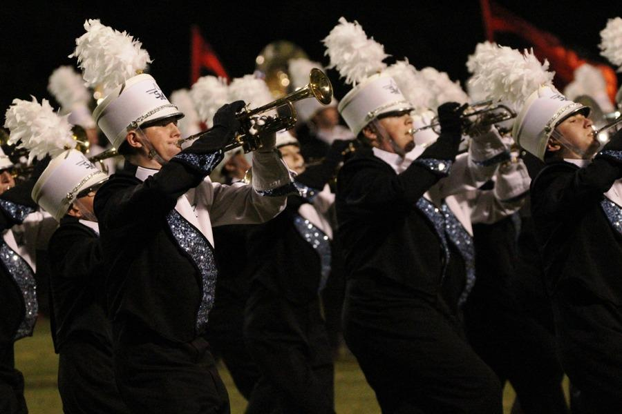 """The trumpet section performs their anger movement. """"We try to create an artistic show that we love performing and is also educational and entertaining and possibly competitive. If we do that, we're successful,"""" King said."""
