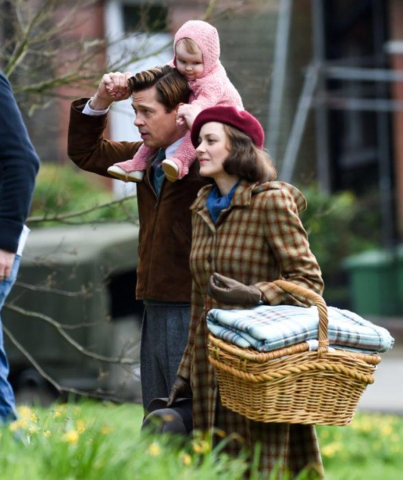 Marianne Beausejour (Marion Cotillard) and Max Vatan (Brad Pitt), with Anna on his shoulders, undergo what they intend to be their best day ever. Since there are limited peaceful moments following the events of World War II, this moment is important to the film as they enjoy a family picnic.