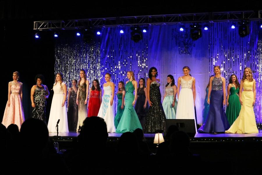 """All 18 contestants stand on stage in the Willie Duke auditorium for the announcement of awards and the crowning of the 2017 Miss Starr's Mill. """"Consistently, the girls say that after participating in the pageant they have more confidence,"""" math teacher and pageant organizer Emily Willis said."""