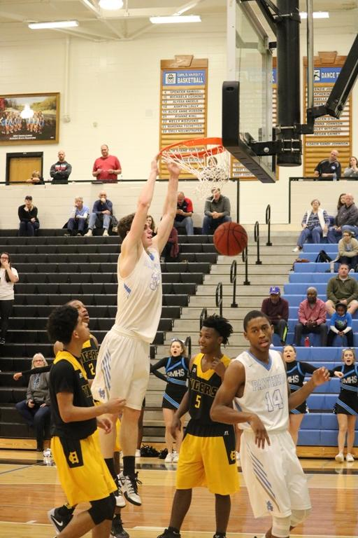 A+Panther+player+dunks+the+ball+during+the+Panthers+first+round+contest+against+Harris+County.+The+back+and+forth+matchup+resulted+in+a+64-58+win+for+the+Panthers.+