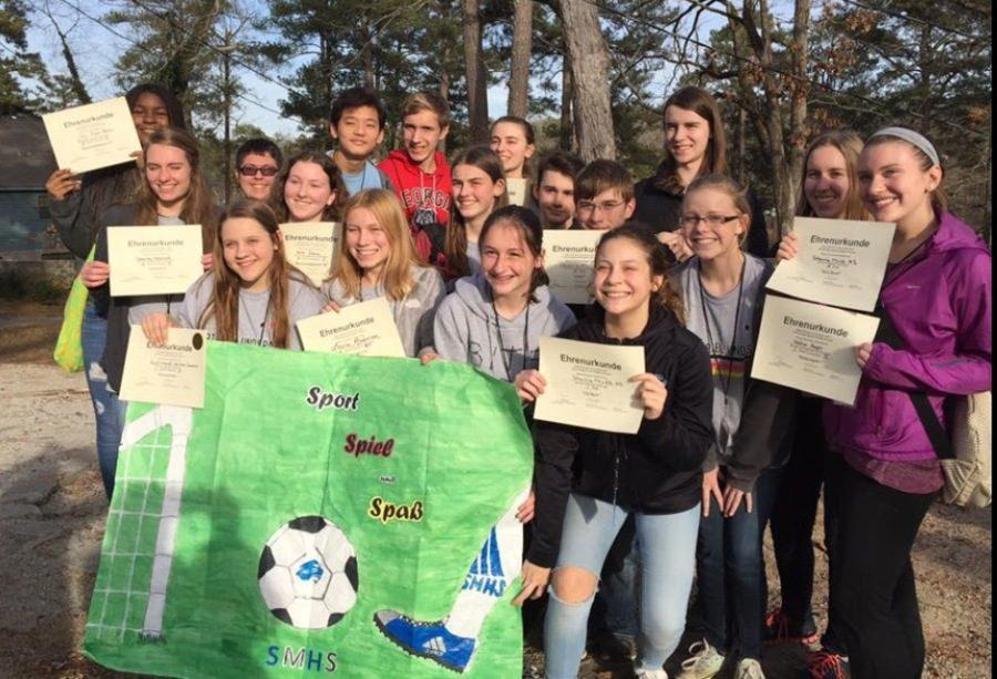 """Starr's Mill's German students hold up their award certificates at the 2017 State German Convention. """"I'm extremely proud of how we did as a whole,"""" junior Marleena Tamminen said. """"We placed in a lot of different events and all levels of German."""""""