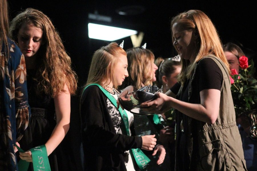 """The female participants of the Peers Are Linking Students pageant are all awarded with a sash and crown. The PALS pageant is an event which allows students with disabilities to shine on stage and interact with their peers. Students at the Mill and at Whitewater High were also able to escort a participant or help backstage. """"So many people from the community are more than happy to help in any way they can,"""" Starr's Mill alumni Elizabeth Keown said."""