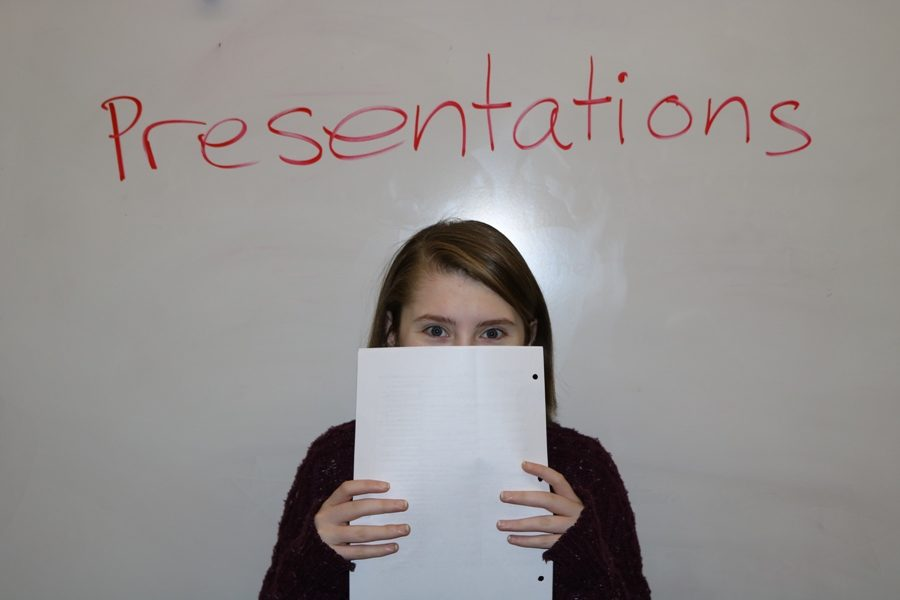 A student prepares to deliver her speech in front of the class. Students who suffer from anxiety may experience a panic attack while presenting material in front of a class, causing a harmful and embarrassing experience for the affected student.