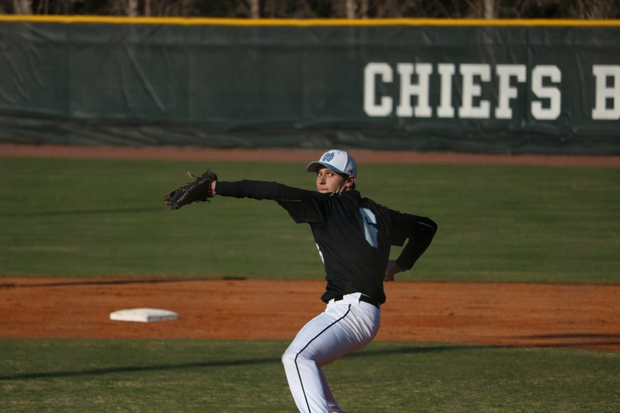 Senior Will Evans throws a pitch off the mound. Evans pitched a complete game shutout against McIntosh, with 10 strikeouts and two hits.