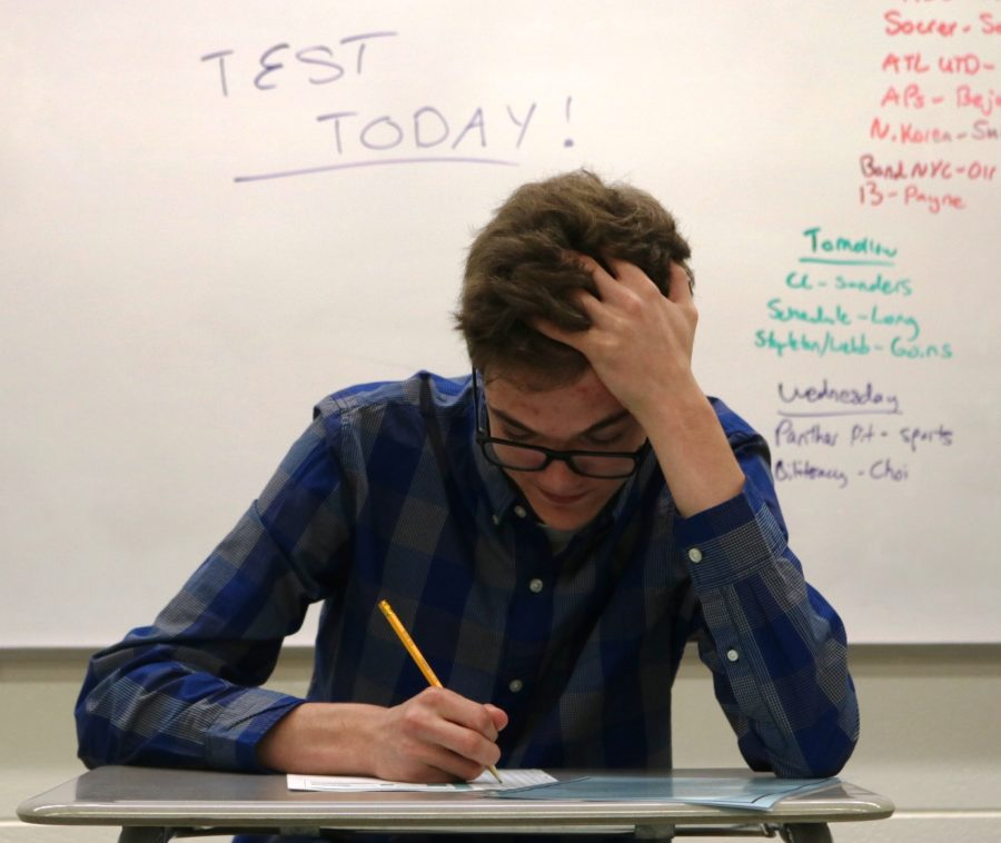 A student struggles to meet the demands of standardized testing. While standardized tests such as the Georgia Milestones and the SAT are often required for academic promotion, many students feel these tests are not an accurate depiction of their intelligence.