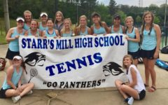 The Starr's Mill girls tennis team takes a picture with their first place trophy after regions. The Lady Panthers won regions 3-0 allowing them to progress to state.