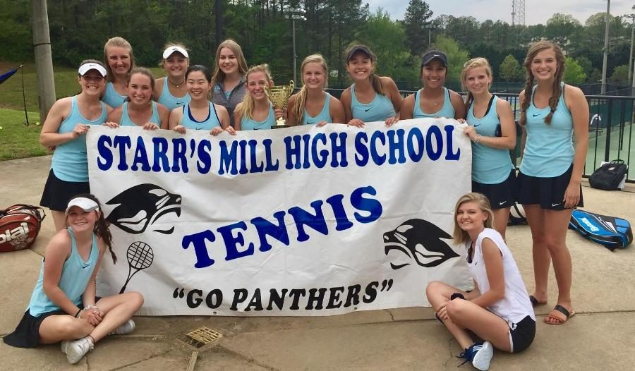 The+Starr%E2%80%99s+Mill+girls+tennis+team+takes+a+picture+with+their+first+place+trophy+after+regions.+The+Lady+Panthers+won+regions+3-0+allowing+them+to+progress+to+state.+