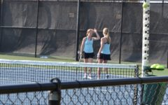 Senior Olivia Walker and sophomore Megan Fox high-five in their doubles match against McIntosh. The Lady Panthers won 4-1 in the match against McIntosh.