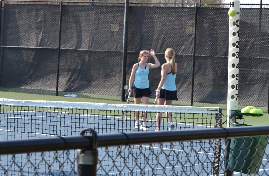 Senior+Olivia+Walker+and+sophomore+Megan+Fox+high-five+in+their+doubles+match+against+McIntosh.+The+Lady+Panthers+won+4-1+in+the+match+against+McIntosh.+