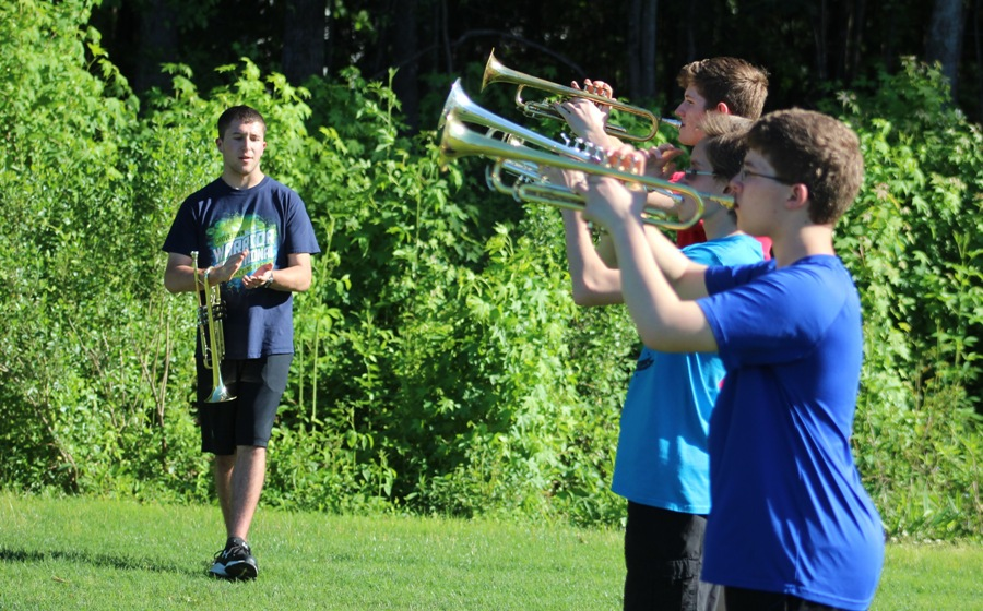 Upcoming senior Ryan Ragsdale assists trumpet members during marching band rehearsal. Panther Pride Marching Band already prepares for their 2017 season, when they will perform a rendition of Swan Lake.