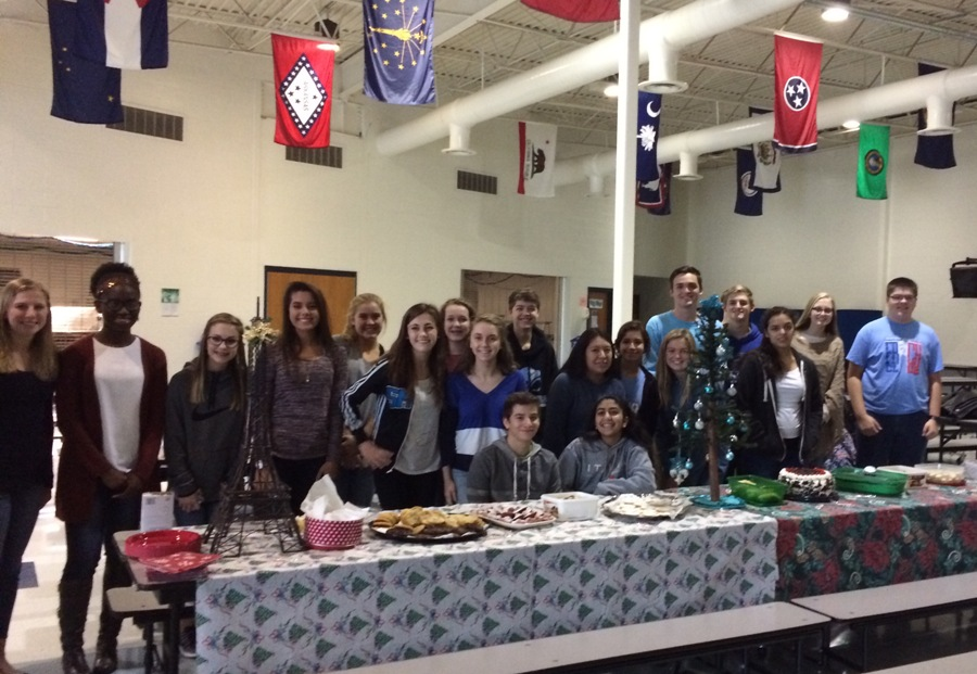 "The French club hosts its annual Christmas party in the cafeteria. Le Cercle Français is a club for any student with an interest in French culture and language. The club itself is ""definitely a great recruiting tool to encourage students to continue their studies of the French language,"" French teacher and sponsor of the club Marie Scott said. Whether it be a club meeting or annual party, Scott seems to always enjoy ""the camaraderie that develop during those times,"" Scott said."
