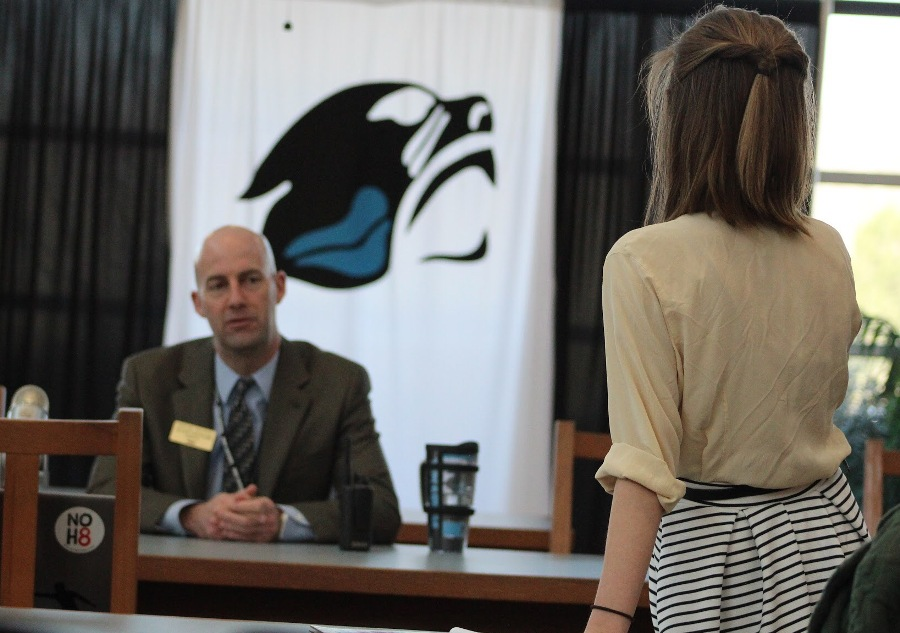 Feb. 11, 2016 - Editor-in-Chief of the Prowler Erin Schilling poses a question to Principal Allen Leonard during a called press conference in the media center. High school journalism programs create opportunities for students to directly voice their concerns to those in power and then report them to the public.