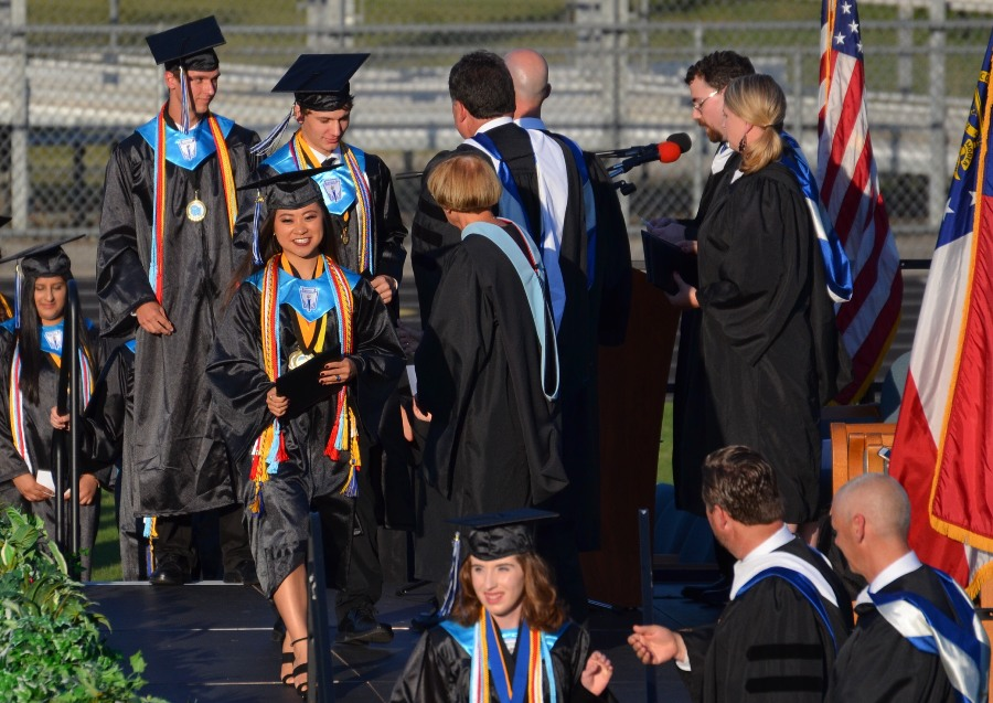 The+first+few+members+of+the+Mill%E2%80%99s+Class+of+2017+to+graduate+flash+broad+smiles+as+they+receive+their+diplomas.+Graduating+from+high+school+is+a+landmark+event+in+most+teenagers%E2%80%99+lives%2C+but+what+comes+after+the+walk%3F