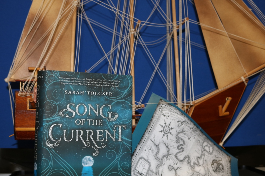 %E2%80%9CSong+of+the+Current%E2%80%9D+is+an+exhilarating+fantasy+novel+that+follows+Caroline+Oresteia+on+her+journey+through+the+Riverlands+to+discover+her+destiny+and+save+her+father.+This+book+is+a+part+of+Uppercase+box%2C+a+program+that+sends+members+a+new%2C+hardcover+young+adult+novel+each+month.++
