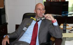 """Principal Allen Leonard poses for a photo in his office on the day of the """"Great American Eclipse."""" """"Safety is number one,"""" Leonard said. """"Number two is making sure that [students] have the proper environment... and the time to be able to accomplish what needs to be done."""""""