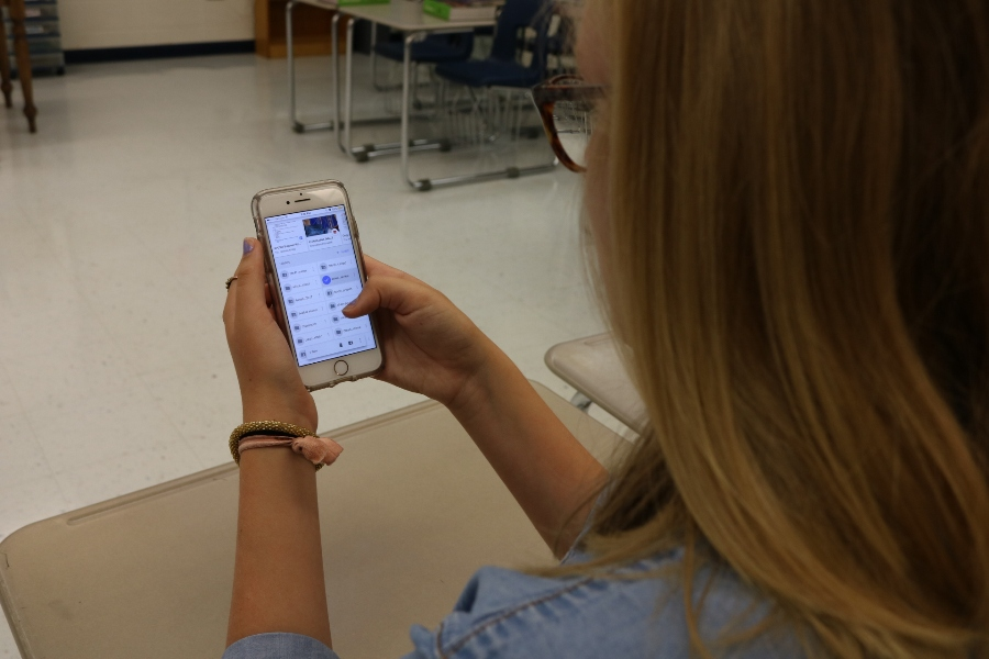 A+student+uses+her+phone+to+access+her+classwork.+With+the+right+apps%2C+students+can+use+their+phones+to+benefit+themselves+in+school.