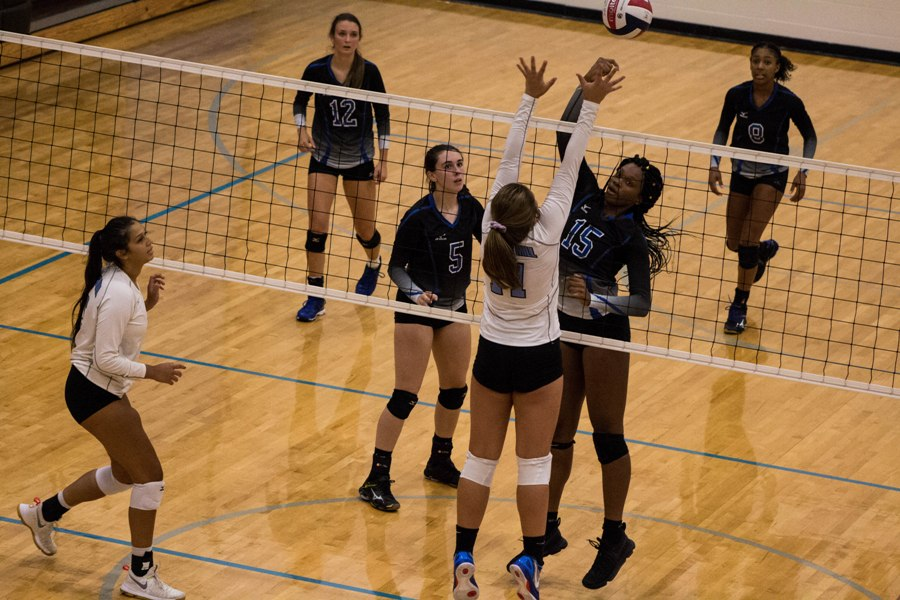 A Lady Panther jumps up to block the ball. On Aug. 22, Starr's Mill split matches against Columbus and Trinity, defeating Trinity 2-0 and losing to Columbus 2-0.