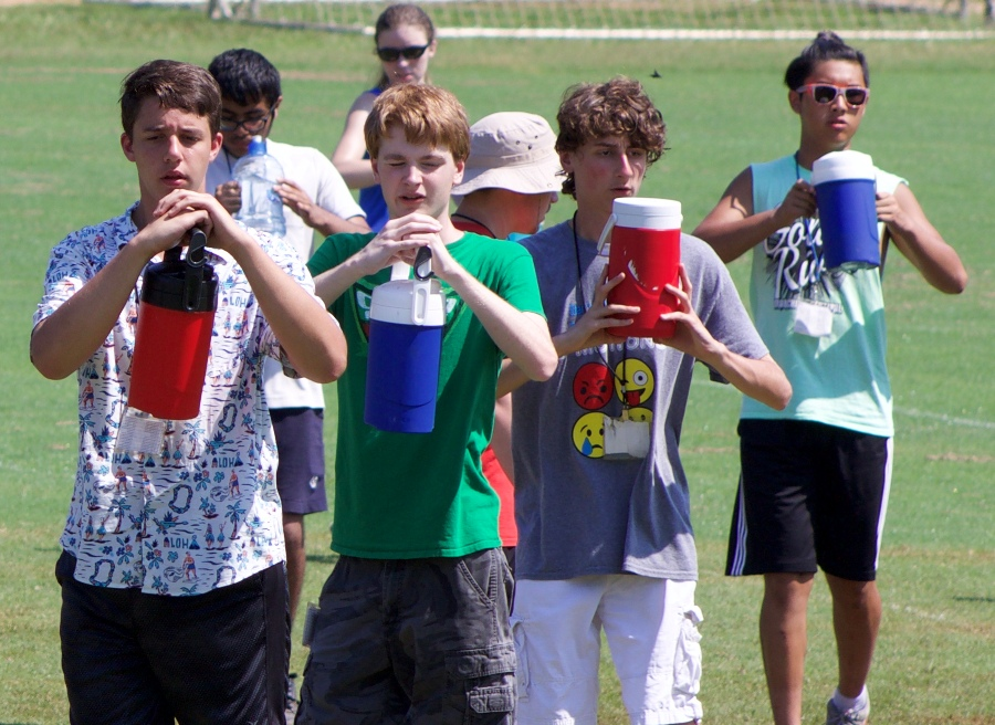 Panther Pride Marching Band students rehearse during band camp in July. The students powered through the Georgia summer heat in order to learn the show.