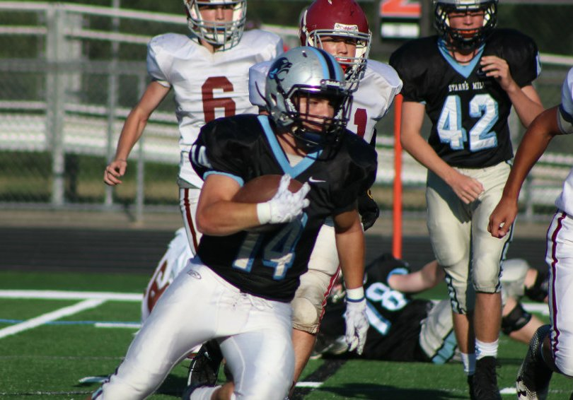 Sophomore running back Ardit Hoti runs the ball. The JV Panthers ran the ball with ease, with running backs scoring all of the team's touchdowns in the 41-14 win.