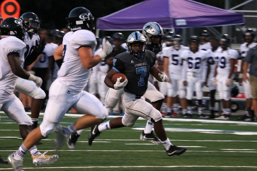 Senior+running+back+Nick+Brown+surveys+the+field+while+running+the+ball.+The+Panthers+out-rushed+Chapel+Hill+340-36+in+their+56-21+victory.