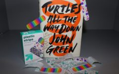 """Turtles all the way down"" focuses on Aza Holmes investigating the disappearance of billionaire Russell Pickett while also struggling with her constant anxiety-ridden thoughts. This wonderfully composed story touches on love, lifelong friendship, and the hardships of mental illness, creating a realistic atmosphere that readers can truly become part of."