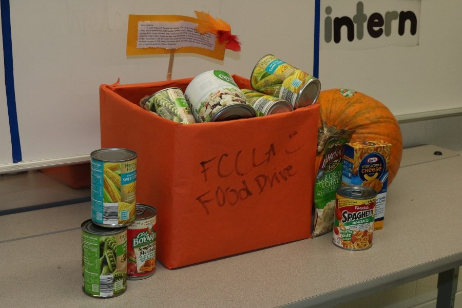 This+orange+box%2C+located+at+the+front+of+Hope+Via%E2%80%99s+room%2C+holds+some+of+the+food+donated+by+students.+The+food+will+be+collected+through+Nov.+3+and+then+delivered+to+the+Fayette+Samaritans.