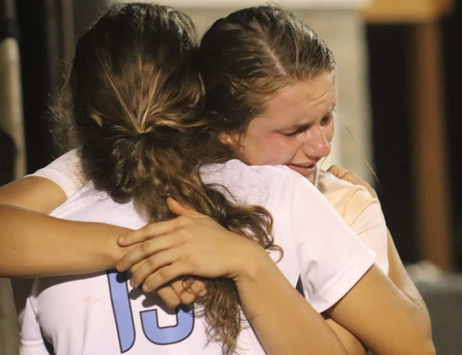 Two Lady Panthers hug after the last game of the night. Despite winning region 3-AAAA, the Lady Panthers fell to Ola in the first round of state playoffs.