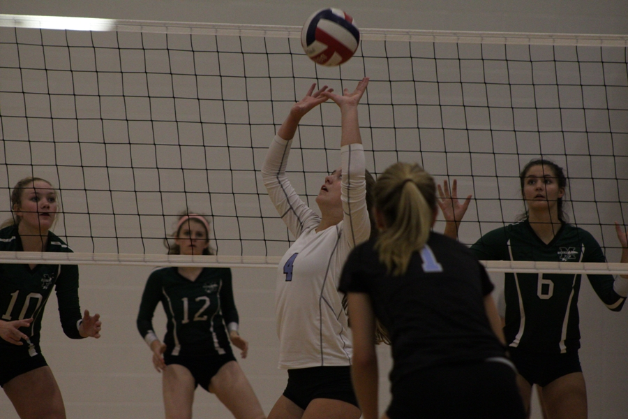A Panther sets the ball for a teammate. The Panthers split the night, beating Griffin 2-0 but losing to McIntosh 2-0.