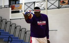 A Harlem Wizard player shows off his skills during pre-game introductions. The Harlem Wizards travel around the world to help raise money for various charities.