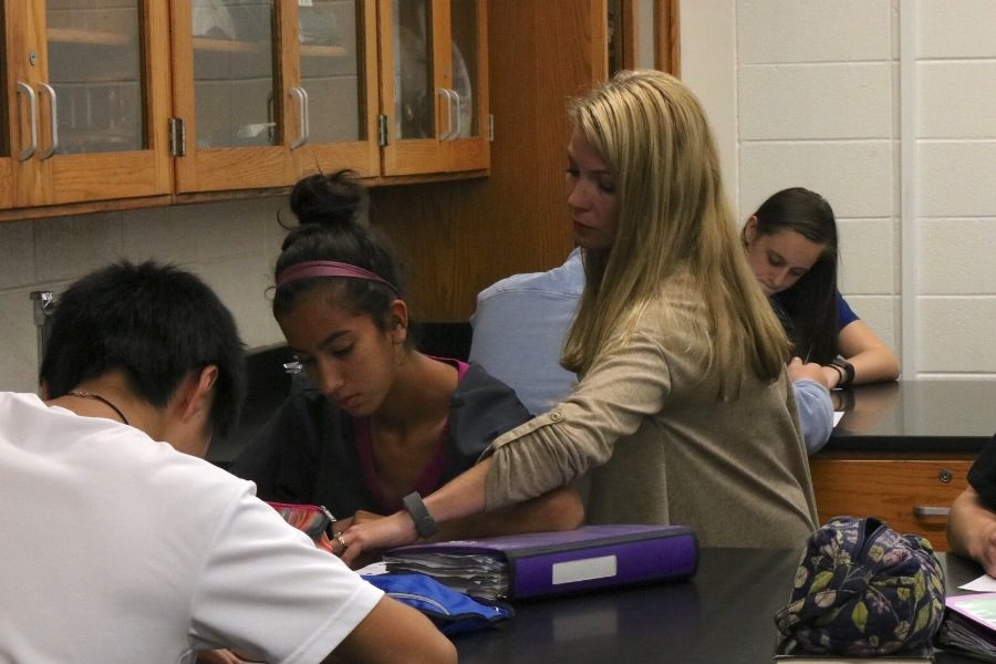 """Kelly Rock earned Teacher of the Year this year for her extreme dedication and passion to inspire her students. """"She has taken the time out of her morning and afternoon to help me with science fair and she always makes sure I understand what I'm doing in Biology,"""" Rock's current student Claudia Williams said."""