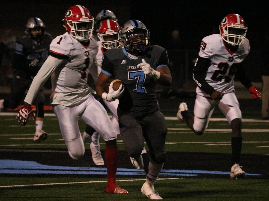 Senior running back Nick Brown races past the Dutchtown defense. Brown rushed for 46 yards and a touchdown, and also broke off an 89-yard kickoff return.