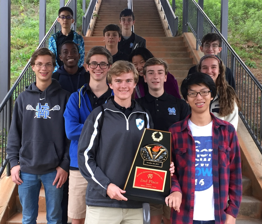 The Varsity Math Team shows off their trophy won at the Thirteenth Annual Rockdale Mathematics Competition. They placed second in team competition and sophomore Brock Spence won the individual round.