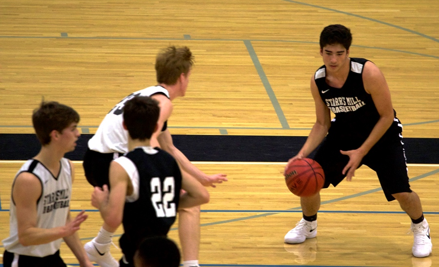 A Panther player in triple threat position. The Panthers' season began with a scrimmage against Our Lady of Mercy in which the Panthers won 74-22.