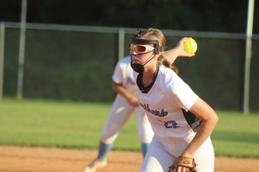 Sophomore Paige Andrews sends a ball to the plate. Andrews was awarded with Pitcher of the Year from the Fayette Daily News of the 2017 year.